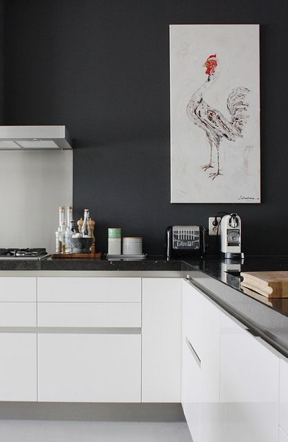 Clean, streamlined achromatic kitchen with a big dose of personality.  I love the rooster!