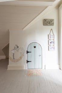 firy door...cute entrance to a small playroom... A Modern Farmhouse Style Tudor in Nashville...