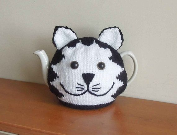 Hand made cat knitted tea cosy , mog, for your teapot. Fits 2 pint, 4-6 cup pot. Great smile. Animal cosy. Postman Pat black and white cat