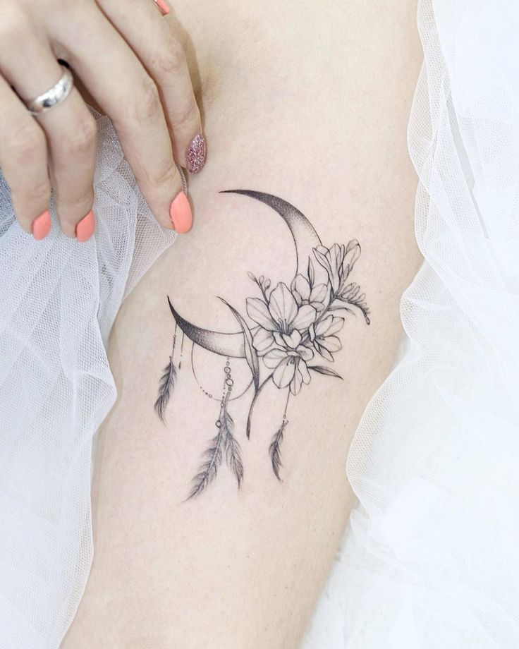 The Coolest Crescent Moon Tattoos (And What They Mean) in 2021   Back of neck tattoo, Feather tattoos, Girly tattoos