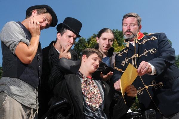 Greg Radzimowski, James Rowley, Tyson Aubin, Luke Zalubniak, Jason Etherington study the document from the princess. Maple Ridge News - Shakespearean steampunk romance