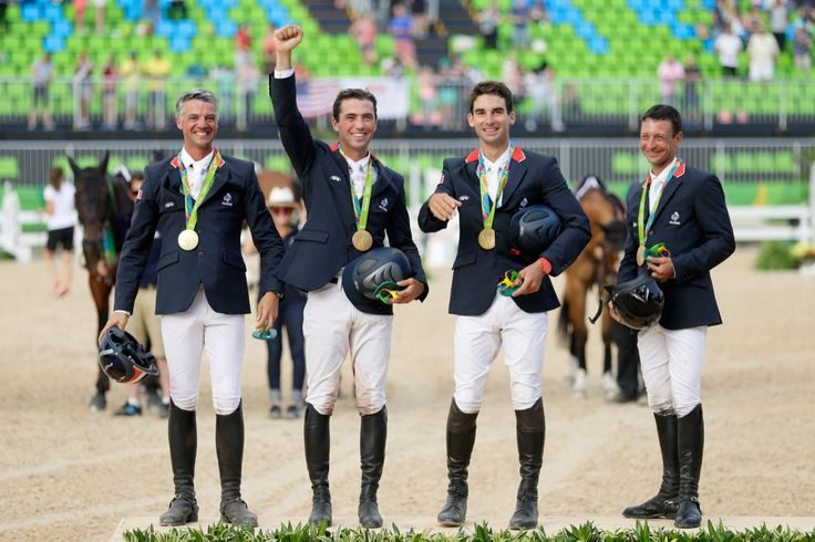 <p>Gold medal medalist's Karim Laghouag, Thibaut Vallette, Mathieu Lemoine and Astier Nicolas of France pose during the medal ceremony for the eventing team jumping final…