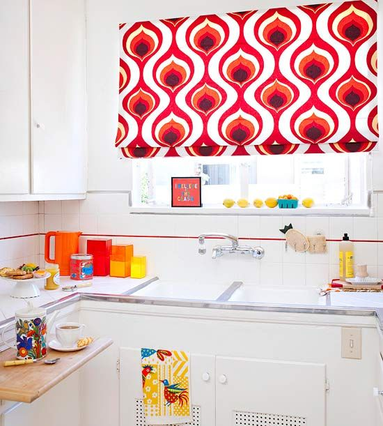 This bold window covering adds a burst of color to this fresh white kitchen. More small-kitchen decorating ideas: http://www.bhg.com/kitchen/small/small-kitchen-decorating-ideas/?socsrc=bhgpin053113windowcovering=6