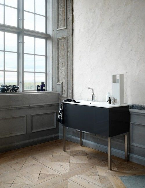 period details of house-original wood floors & detailing on walls, contemporary black cabinet & sink
