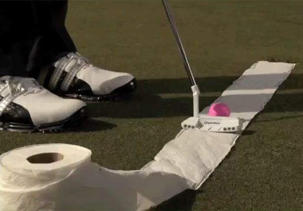Another good trick for your putting is to lay some toilet paper on the ground and down into the hole. It'll give you a clear visual of the line your ball, and your putterhead, should be traveling as you putt.