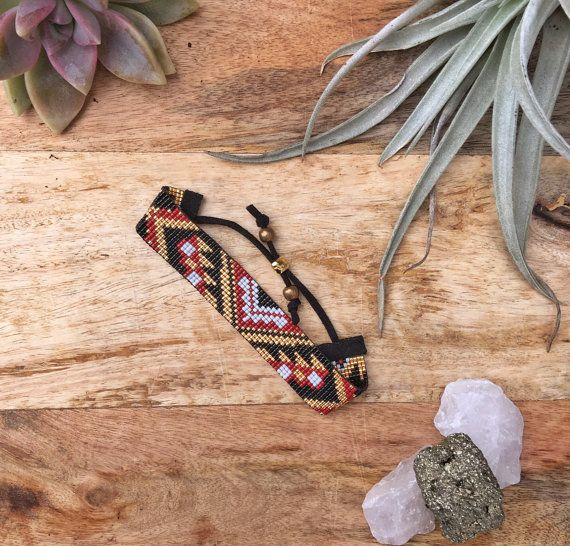 This is a fully adjustable, vegan, loom beaded bracelet made with the finest materials available. I weave each piece by hand with my little loom in Cumbria, England. The Spiced Chai design features Miyuki Delica beads in a black, brick red/maroon, gold, and white tribal-inspired geometric