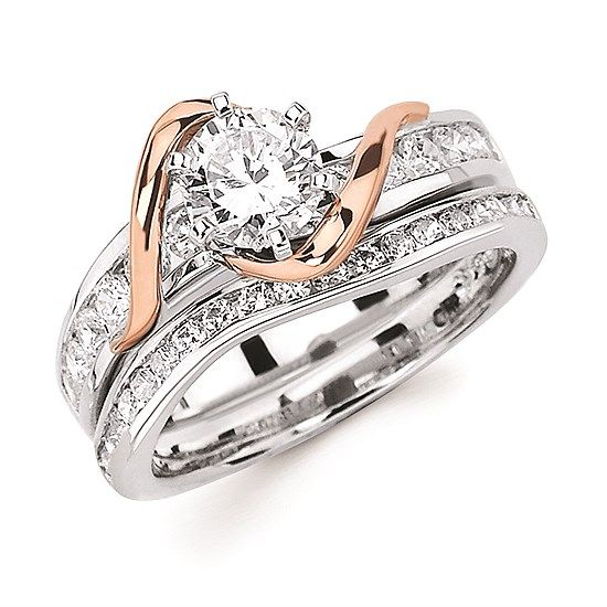 Channel set white gold bridal set with rose gold swirl accent.