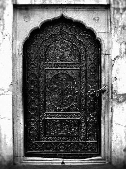 Always thought there was something imposing and striking about a large iron door in the front of a house.
