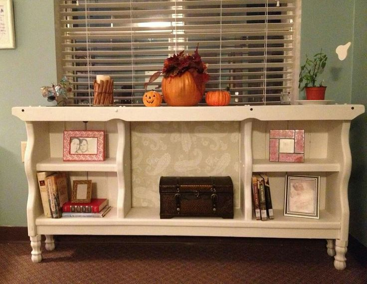 AN OLD WATERBED HEADBOARD IS TURNED INTO A BOOKCASE SHELF... This is such a neat idea!