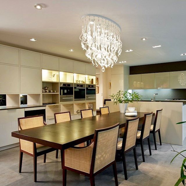 Luxury dining room together with kitchen. Chandelier as the dominant of the room. Our realization, Prague - Czech republic.