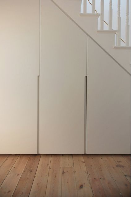 Concealed under stairs cupboard for Utility. Make the door design the same as the WC so concealed and Wow the inside so a nice surprise