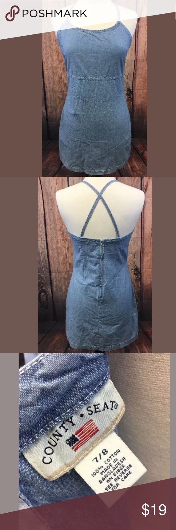 "Vintage 90s Denim Dress Size 7/8 blue chambray Vintage 90s Denim Dress Size 7/8 blue chambray; County Seat, 100% cotton, criss cross back; minor wear/loosening to side seam- see photos; 17"" pit to pit, 16"" across front of waist, 18-1/2"" across front of hip, 33-1/2"" from top of shoulder down to bottom county seat Dresses Mini"
