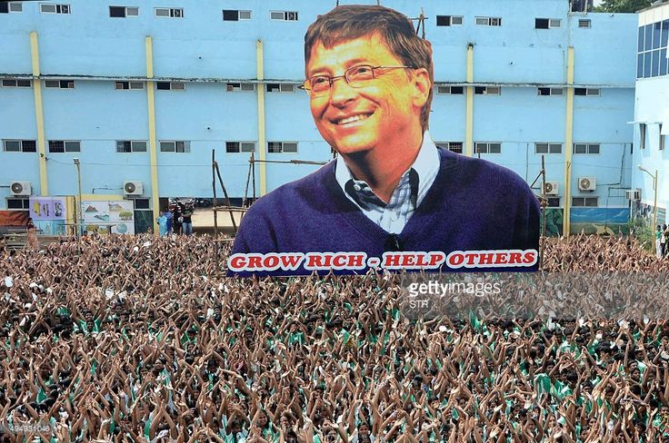 Indian schoolchildren gather around a cutout of Microsoft founder and philanthropist Bill Gates to mark his 60th birthday, at a school in Chennai on October 28, 2015.