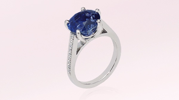 Solitaire ring in platinum, diamonds, set with a sapphire. Reference : J311SB #Engagement