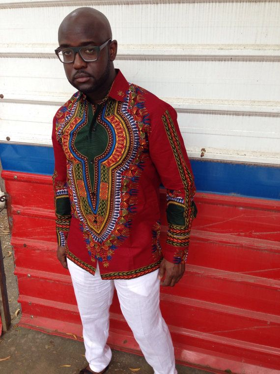 Get the awesome design of dashiki in a more sophisticated look with these button down dress shirt. This shirt can be worn on a casual day out, or for a special occasion such as a wedding or evening out.  Shipping These shirts are made to order in Ghana West Africa. Production takes 2-3 weeks. This item will be shipped with courier service dhl and takes 2-4 days depending on your location. If you would prefer regular shipping, please let us know.  Colors Shirt is available in brown, burgundy…