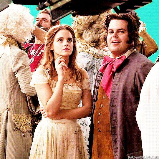 Emma Watson as Belle and Josh Gad as LeFou on set gif
