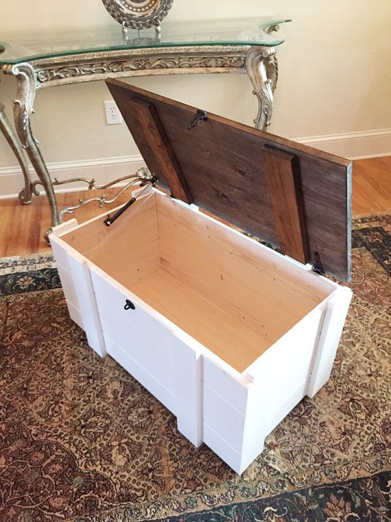 The Traveler Chest  Mountain Creek Woodworks is proud to present The Tucker Chest. The chest is 100% USA, handmade in a barn in North Georgia. Constructed from Georgia white pine and finished with satin white paint and dark walnut stain. Much attention to detail and fine craftsmanship has gone into the building of this piece. The lid is securely fastened to the chest with 2 decorative hinges for added strength. The lid is supported by a gas-powered strut for added ease. The possible uses for…
