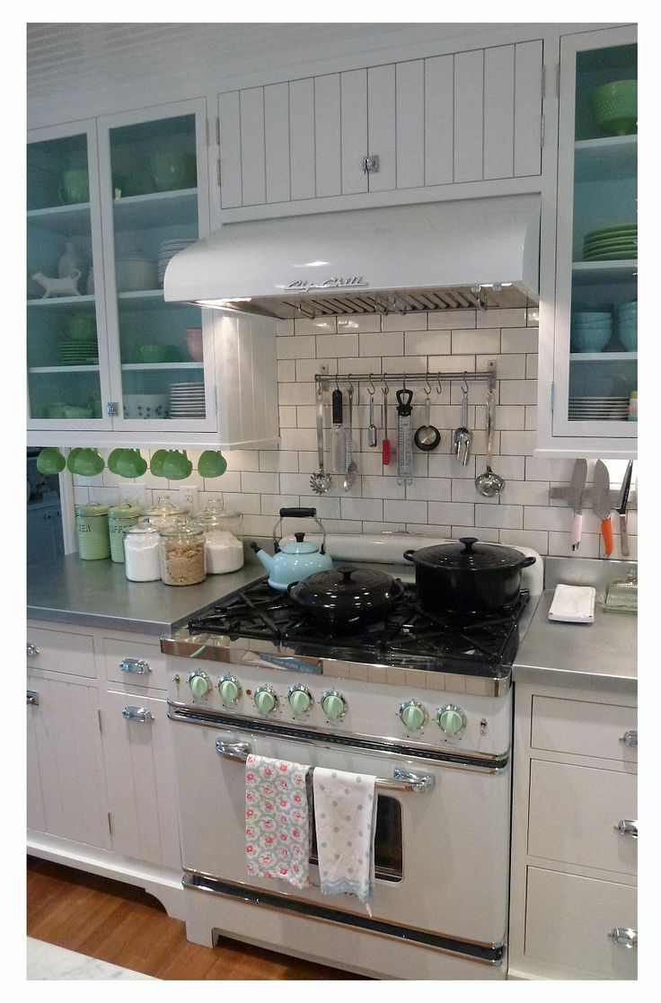 Perfection! Big Chill stove, glass front cabinets, and jadeite, oh my!