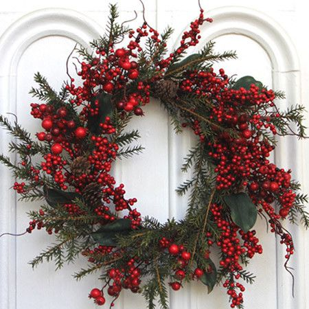 Faux cedar and berry wreath. Product: WreathConstruction Material: Faux cedar and plasticColor: Red ...