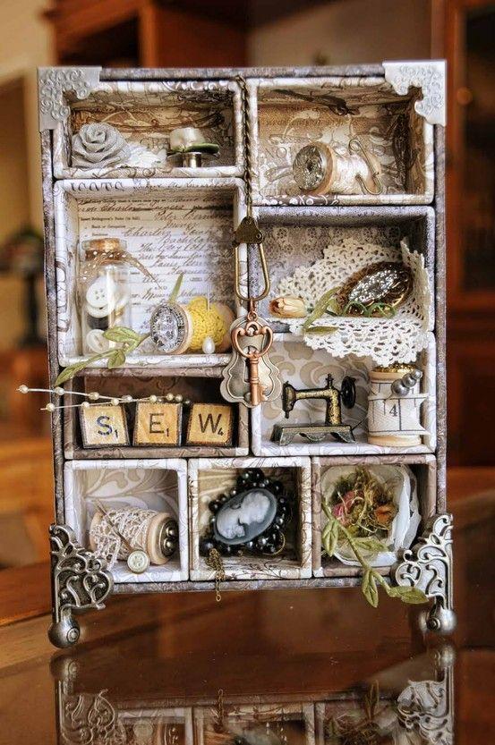 Shadow box of vintage miniature items