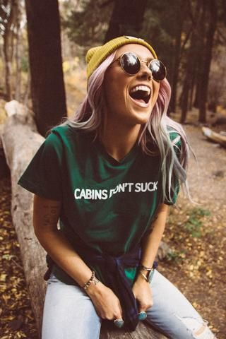Some shirts are more opinionated than others. Unisex evergreen tee with white lettering. Tory is wearing an XS, Alexis is wearing a M.
