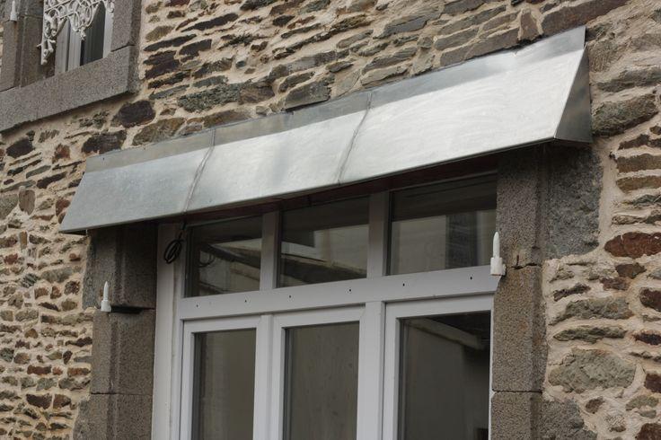 Protection d'un linteau bois par structure en zinc soudé