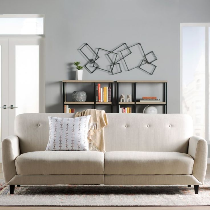 Anchor a midcentury modern ensemble with this eye-catching sofa, featuring a clean-lined design and gently tufted details. When overnight guests arrive, simply fold down its back to make a comfy and stylish bed.