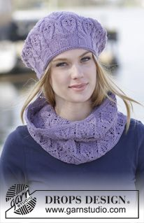 """Set consists of: Knitted DROPS hat with cables and leaf pattern and knitted neck warmer with leaf pattern in """"Merino Extra Fine"""". ~ DROPS Design"""