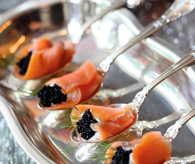 Beluga Caviar wrapped in salmon filled with creme fraiche, and topped with a fresh sprig of dill (or any herb)