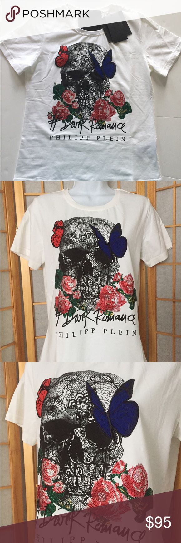 """Philipp Plein """"Dark Romance"""" T Shirt Sz 12 New New With Tags Philipp Plein crew-neck t-shirt Sz 12. On front- a large scull with butterflies and roses studded with sparkling rhinestones.  Short sleeves. Cotton blend. Length 23"""", sleeve length 7.5"""", shoulder to shoulder 15"""", armpit to armpit 18"""". The material is stretching. Looks amazing!!!  Was bought at designer 's sample sale in NYC. Philipp Plein Tops Tees - Short Sleeve"""