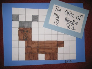 "Animal Area: ""I gave them a piece of one inch grid paper. They had to use the squares to create one of the animals we have been studying.  After a practice sheet, they had to recreate it with markers on a new piece.  When finished, they had to document the area of their animal."""