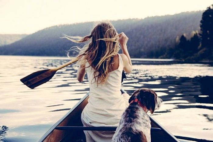 Woman canoeing with dog -- looks like a painting. Absolutely love the light in this photo.