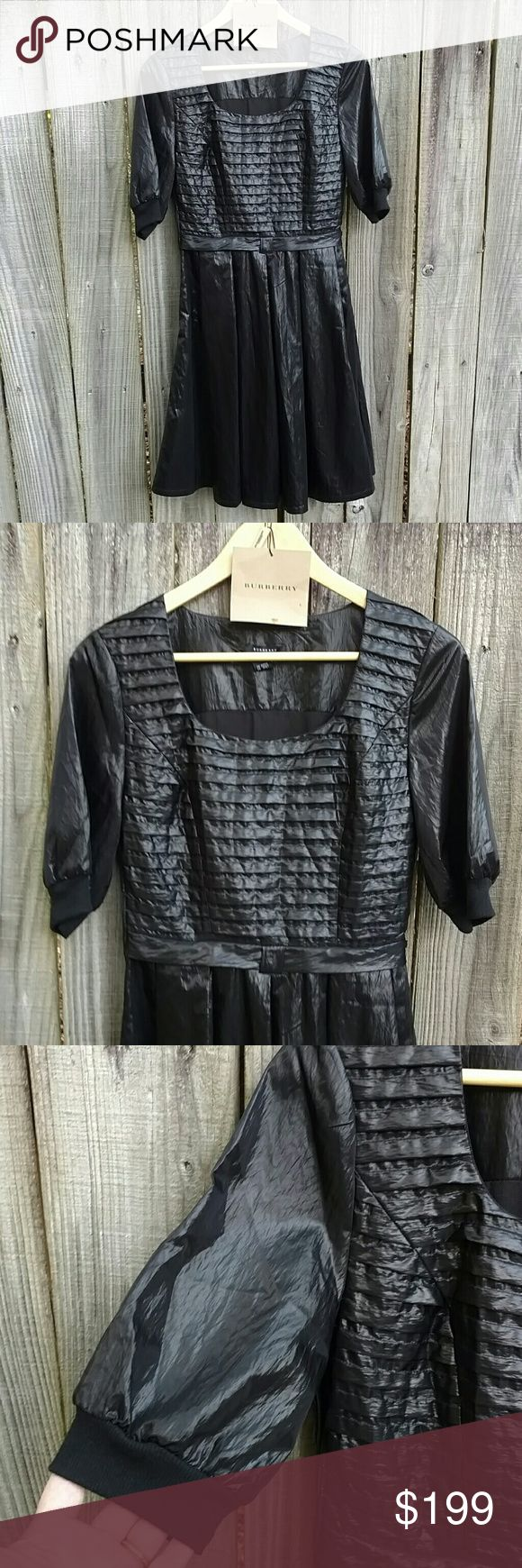 Burberry Black Label Dress Scoop neck dress. Short sleeves with knit cuff. Pleated fitted bodice and full skirt. Side zipper. 100% cotton, size L. Tags included. Burberry Dresses