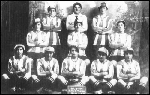 Blyth Spartans Munition Girls - Munitionette Cup Winners 1918-The women working in factories began to play football during lunch-breaks. Teams were formed and on Christmas Day in 1916, a game took place between Ulverston Munitions Girls and another group of local women. The munitionettes won 11-5. Soon afterwards, a game between munitions factories in Swansea and Newport. The Hackney Marshes National Projectile Factory formed a football team and played against other factories in London.