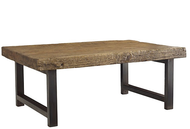 reclaimed elm and steel table rides an appropriate line between country contemporary and urban Zen