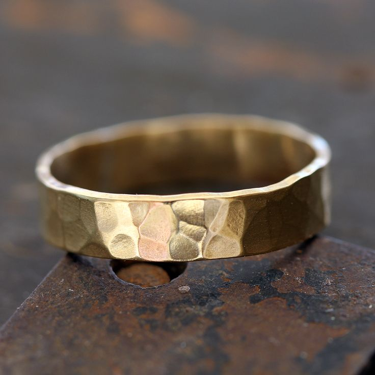 14k gold hammered ring. Unique hammered gold men's or woman's wedding ring. A simple and easy to wear ring that lets the natural beauty of the gold stand out. The ring measures about 4-5mm wide. The r