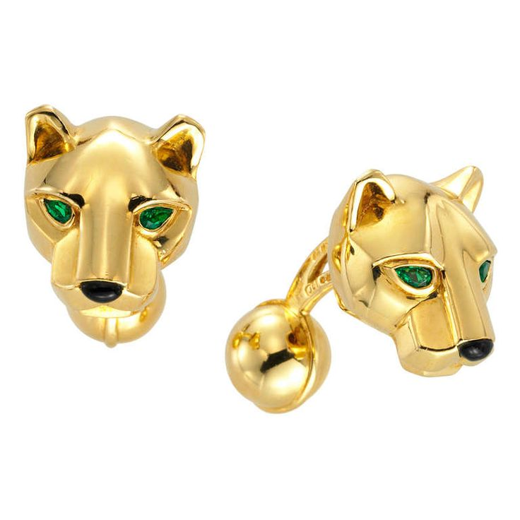 Cartier, a Pair of Onyx and Emerald Panther Cufflinks, each depicting a panther head, emerald eyes and onyx muzzle, mounted in yellow gold, with French hallmarks, gross weight 24.75 grams, signed Cartier, numbered 652151, circa 1980s.