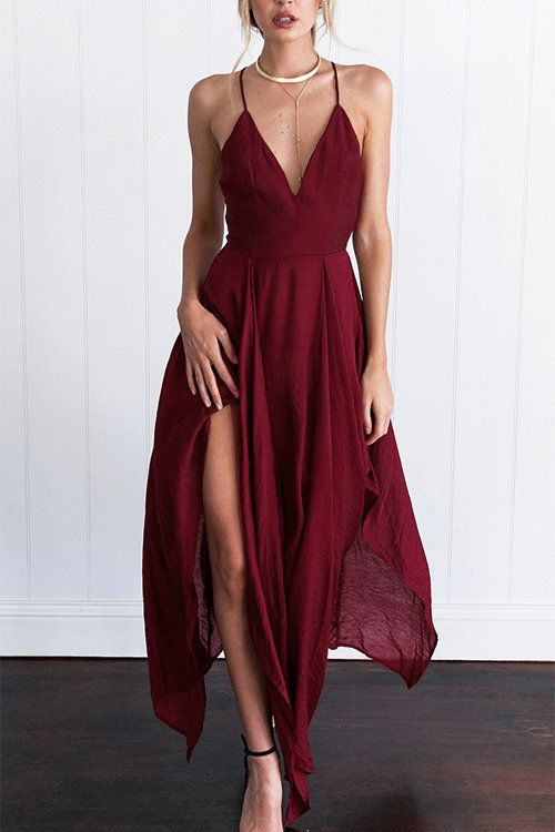 Sing your siren song in this sexy maxi dress. Sheer chiffon fabrication in a relaxed-fit A-line construction cut to a maxi length with a uneven, sheer flowing hem. Features a deep V neck + sleeveless. Finished with a strappy criss-cross back. Lined.