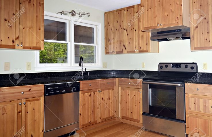 Small kitchen area with knotty pine cabinets kitchen for Knotty pine kitchen cabinets