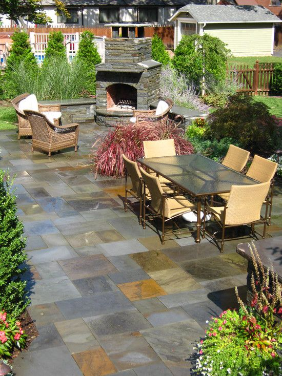 Classic Slate Floors for Interior and Exterior: Traditional Slate Patio Floor With Traditional Outdoor Fireplace With Stones Fire Surround And Rattan Outdoor Armchairs Also Charming Outdoor Dining Furniture With Cream Armchairs Accent Also Beautiful Green ~ kitchentablecomics.com Floor Ideas Inspiration