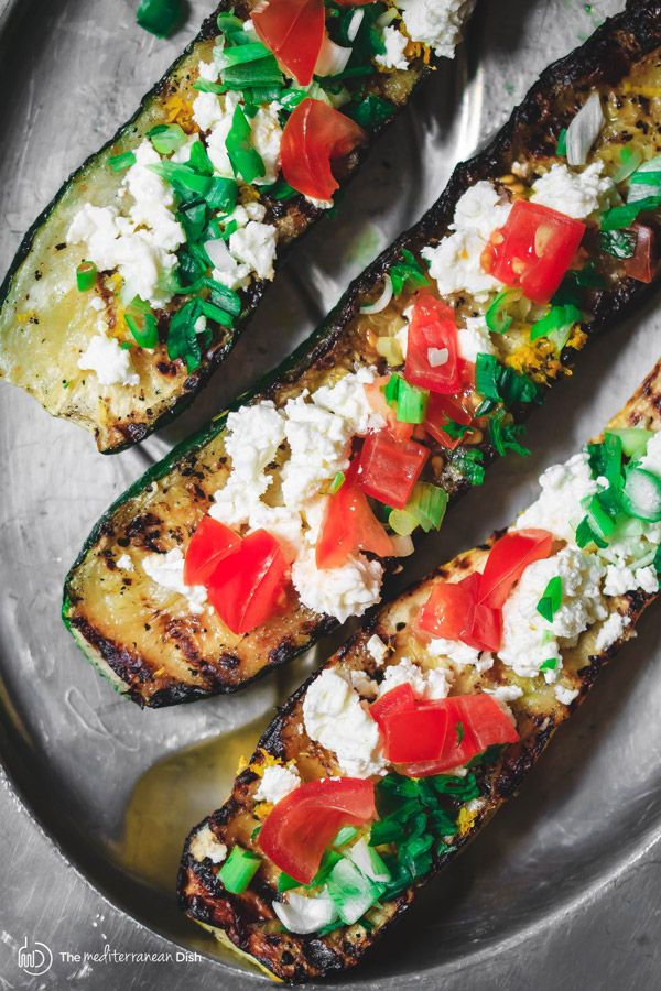 In less than 15 minutes, you can have this easy Mediterranean grilled zucchini! With olive oil, lemon zest, tomato and feta! The prefect appetizer or side!