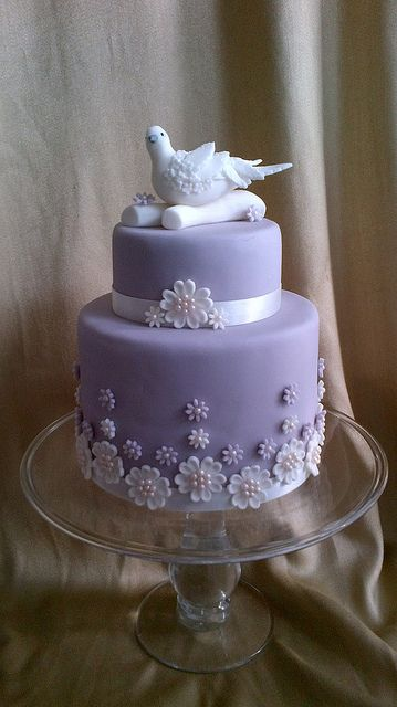 Too pretty to eat!  Lilac cake complete with dainty flowers and gorgeous sitting dove.  By Peggypal