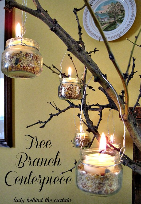 Lady Behind The Curtain - Tree Branch Centerpiece ...she made the votives with baby food jars!!!!  instructions are in the post