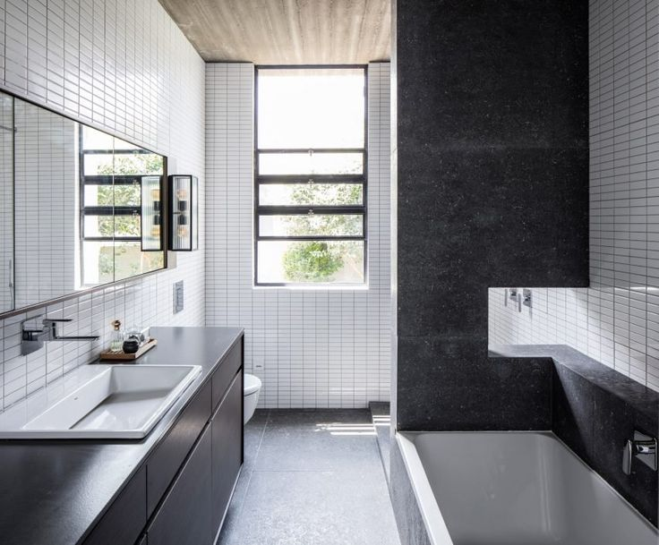 Israeli Architect Couple Use Concrete Blocks To Build Themselves A Home Among Fruit Trees HousesBathroom InteriorBathroom