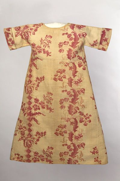"""Wrapping gowns were a form of daytime clothing worn by babies and young children between about 1700 and 1800. They were loose fitting, but often worn with a sash around the waist. The adoption of wrapping gowns and other similar garments for children as daywear was probably influenced by Asian clothing given to the families of those who had trade links with the region. Lord Shelburnes two year old son Lord Fitmaurice had a jummer (jama) of flowered gauze over blue silk in 1768."""