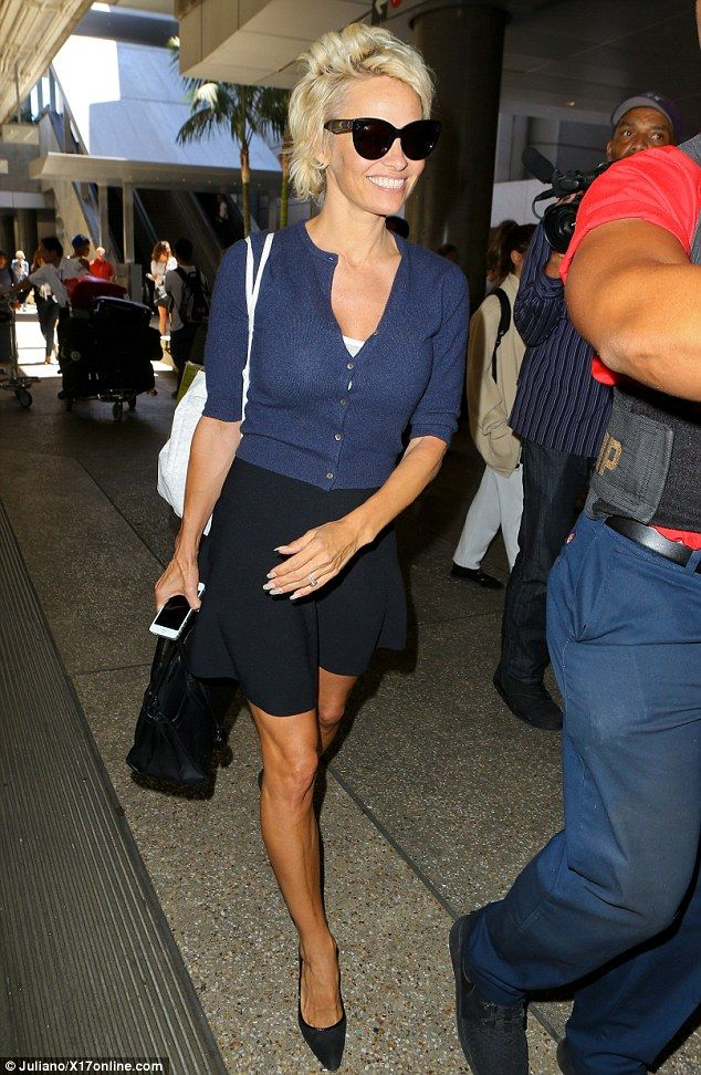 First class! Pamela Anderson looks lovely in sexy blue outfit at LAX #dailymail