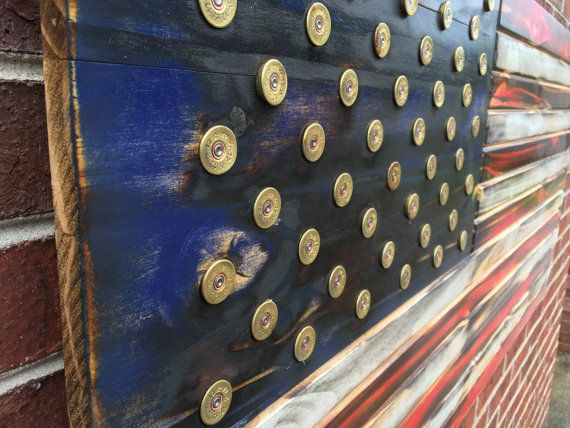 One of a kind Red White and Blue Wooden America flag. The stars and stripes are engraved to give a true genuine look and the Red, White and Blue are
