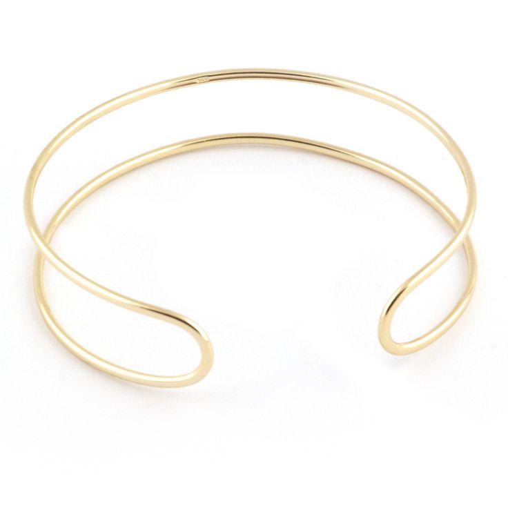 Pulsera esclava de plata chapada en oro. Talla única que puedes ajustar a tu medida. Ancho aproximado 1,2 cm