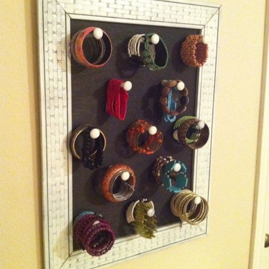 Another Bracelet Storage method.  Pretty hooks or porcelain cabinet knobs on a long screw.  Easier access than a long dowel full...