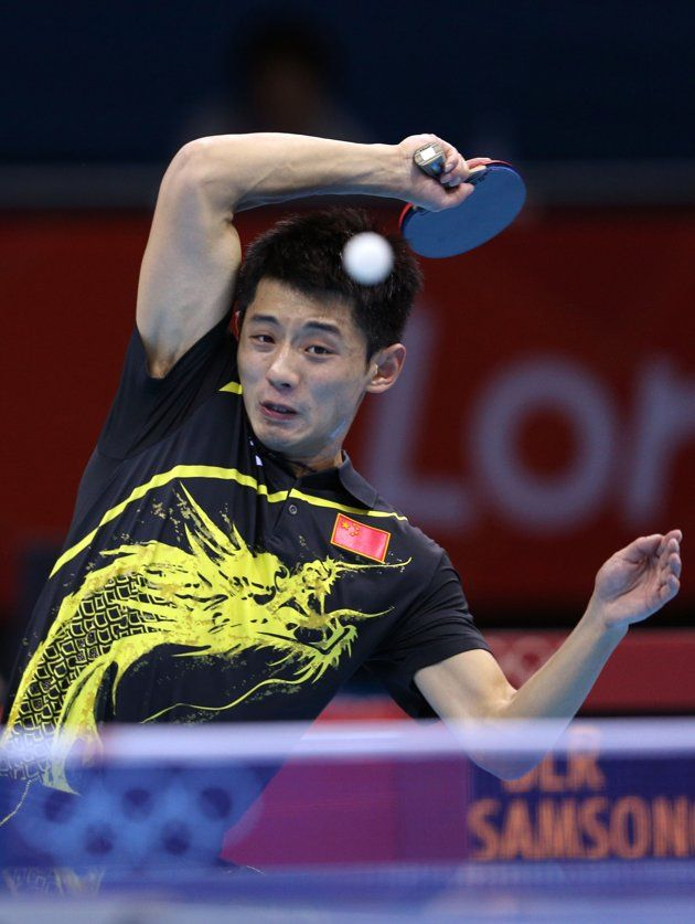 Day Three - JULY 30: Zhang Jike of China returns the ball during his Men's Singles Table Tennis fourth round match against Vladimir Samsonov of Belarus on Day 3 of the London 2012 Olympic Games at ExCeL on July 30, 2012 in London, England. (Photo by Feng Li/Getty Images)